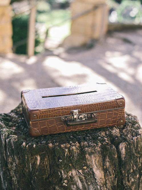 L' urne valise marron vintage