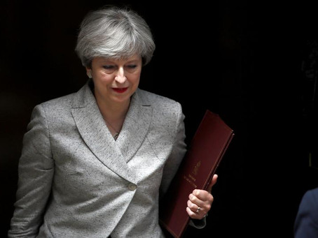 May inches toward deal to stay in power as battle rages over Brexit – Reuters