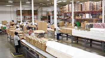 Bulu Warehouse and staff