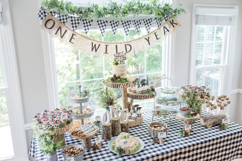 One Wild Year - Boy's 1st Birthday Party - Ideas, inspiration, decor, party food and menu, kids activities and games, cake smash photo session, bear theme, wild one wilderness theme, decorations, cake, cookies, and more!