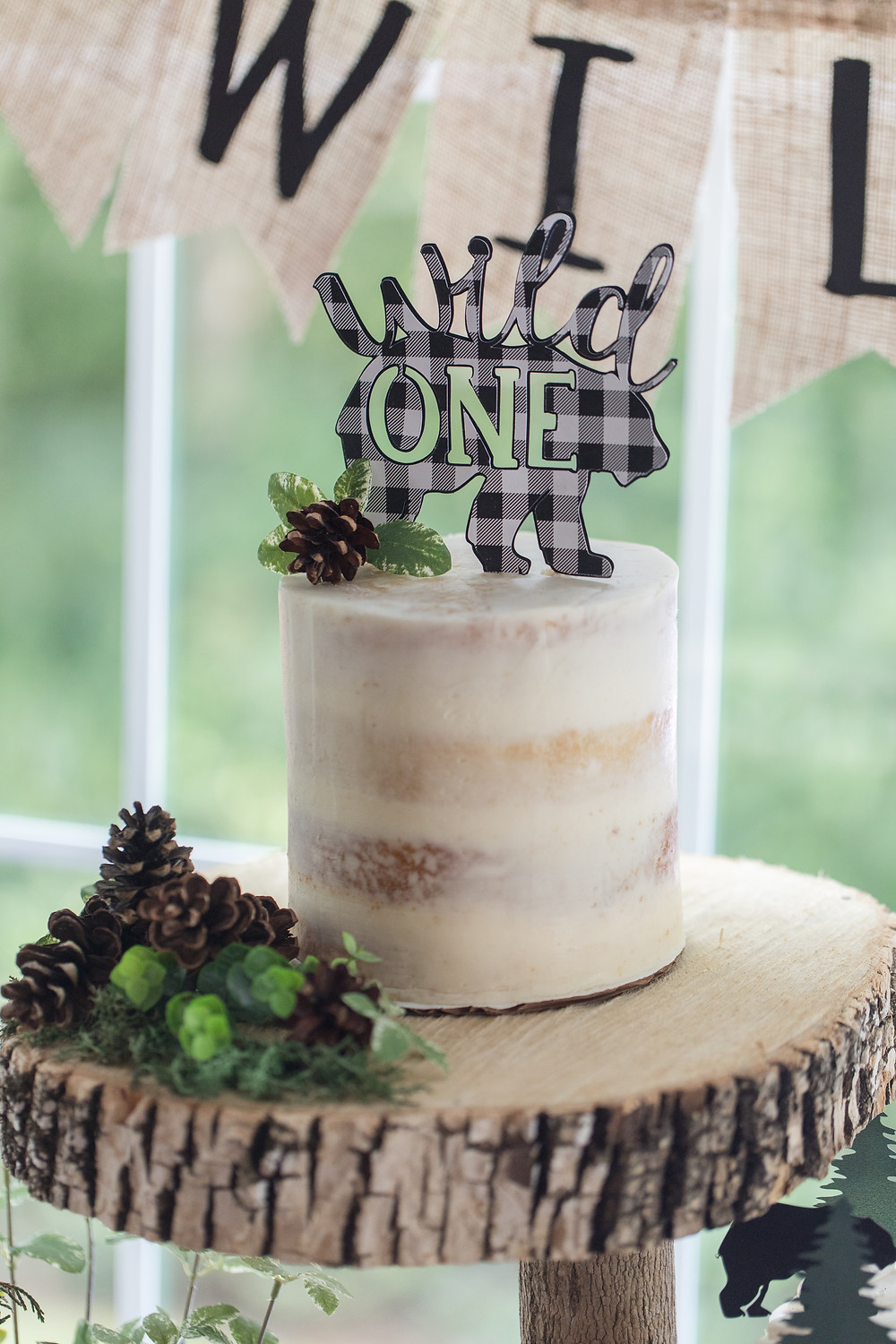 Smash Cake Semi Naked Birthday Cake - One Wild Year - Boy's 1st Birthday Party - Ideas, inspiration, decor, party food and menu, kids activities and games, cake smash photo session, bear theme, wild one wilderness theme, decorations, cake, cookies, and more!