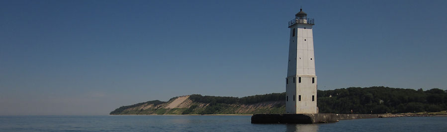 The North Breakwall Light and sandy bluffs in Frankfort, MI