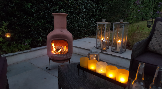 Chimenea and candles give atmosphere in your garden on a Summers evening.