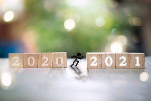 148681540-a-young-man-jump-between-2020-