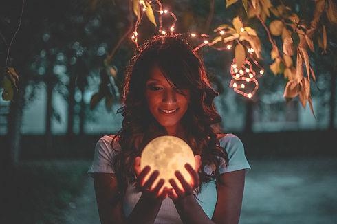 Canva - Woman Holding Moon Lamp.jpg