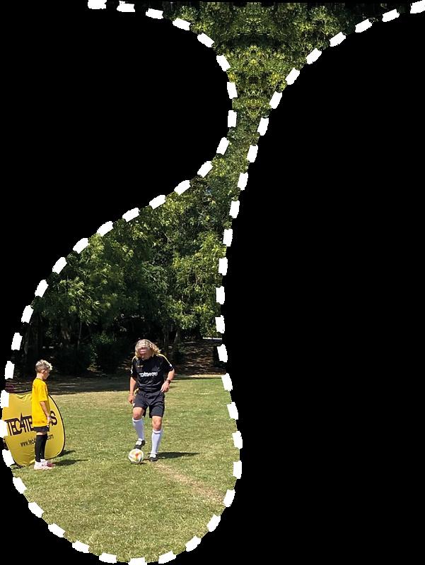 Photograph of coach Gwynne teaching a boy in the park