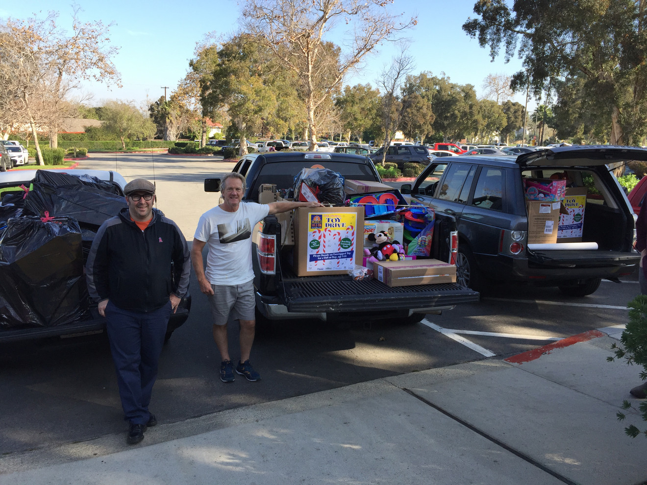 Mike Boyle and Andrew Beeker delivering a load of toys