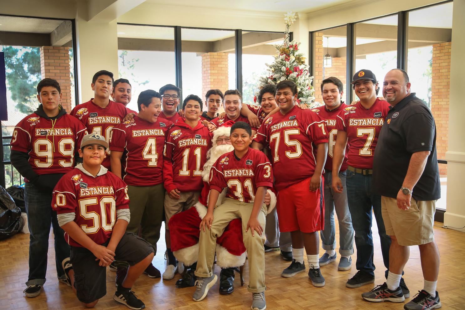 Estancia HS football volunteers and Coach Bargas (R)