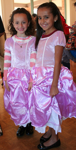 Two happy girls get new dresses from Santa Claus
