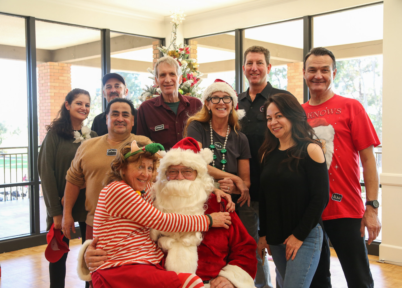 Susan & Tom Neas, Brent Kahlen, event chair Troy Davis, Al Freeman, Guillermo, event co-chair Barbara Davis, Angela (NMUSD), Elf Judy and Santa Claus