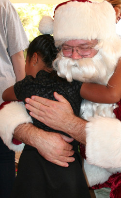 Holiday love goes both ways as Santa gets a big hug
