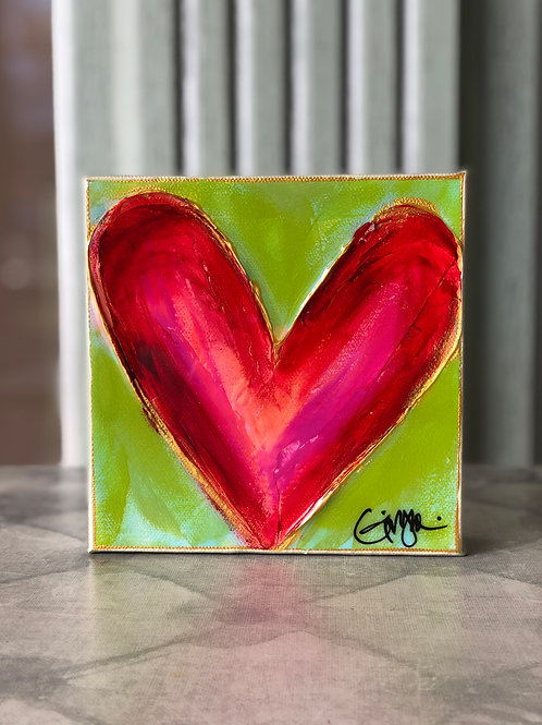 Red Heart on Green Canvas on Wood