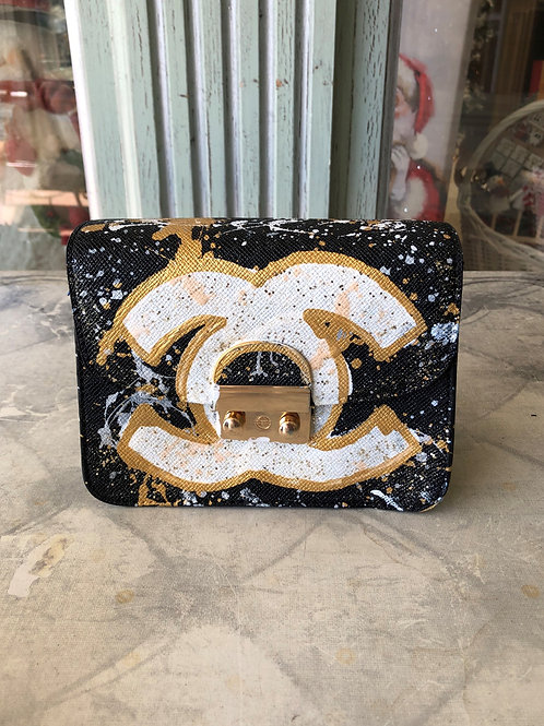 Anca Barbu Black and Gold Chanel Clutch