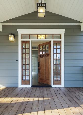 Vertical shot of wooden front door  of a