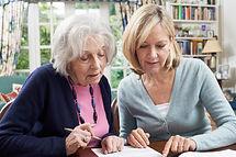 Female Neighbor Helping Senior Woman To