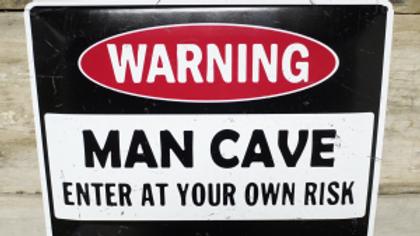 Warning Man Cave tin sign