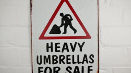 Heavy Umbrellas for sale tin sign
