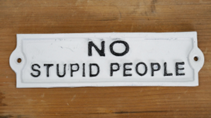 No Stupid People cast iron sign