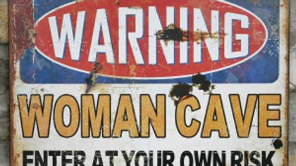 Warning Woman Cave tin sign