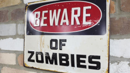 Beware of Zombies tin sign