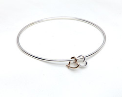 Bangle with two small hearts