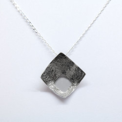 Reticulated cut out pendant