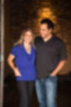Noelle & Roberto Espinosa standing in the doorway to their underground cellar