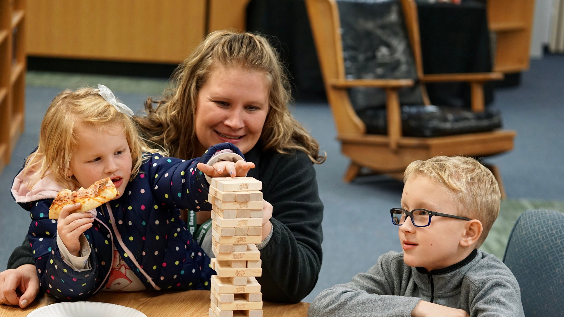 children playing jenga