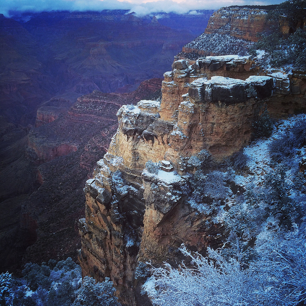 A photo taken of the Grand Canyon south rim with a dusting of snow.