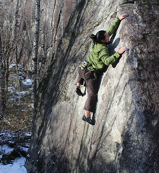 A photo of a climber bouldering.