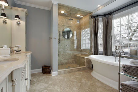 Master bathroom, full glass shower doors, shower, seat and skirted tub
