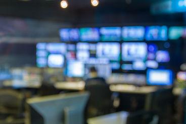 blurred image against television studio.