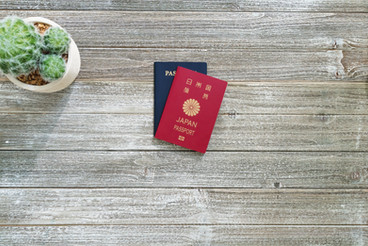 US and Japanese passport on a wooden des