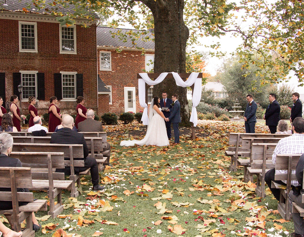 Image of couple at rustic outdoor wedding.