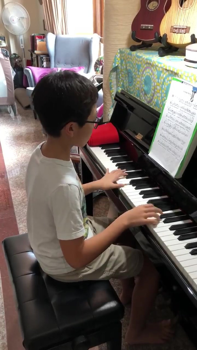 Student playing 'You raised me up'