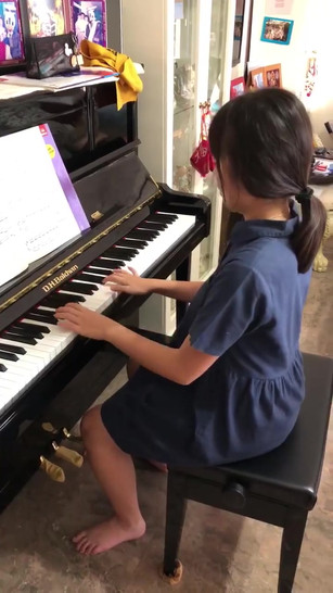 Student playing a Grade 6 piece - Invention in A minor