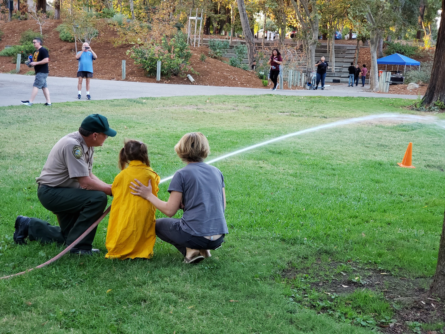 Kid learning to use a fire hose.jpg