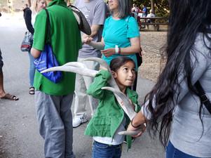 Kid holding an elk antler.jpg