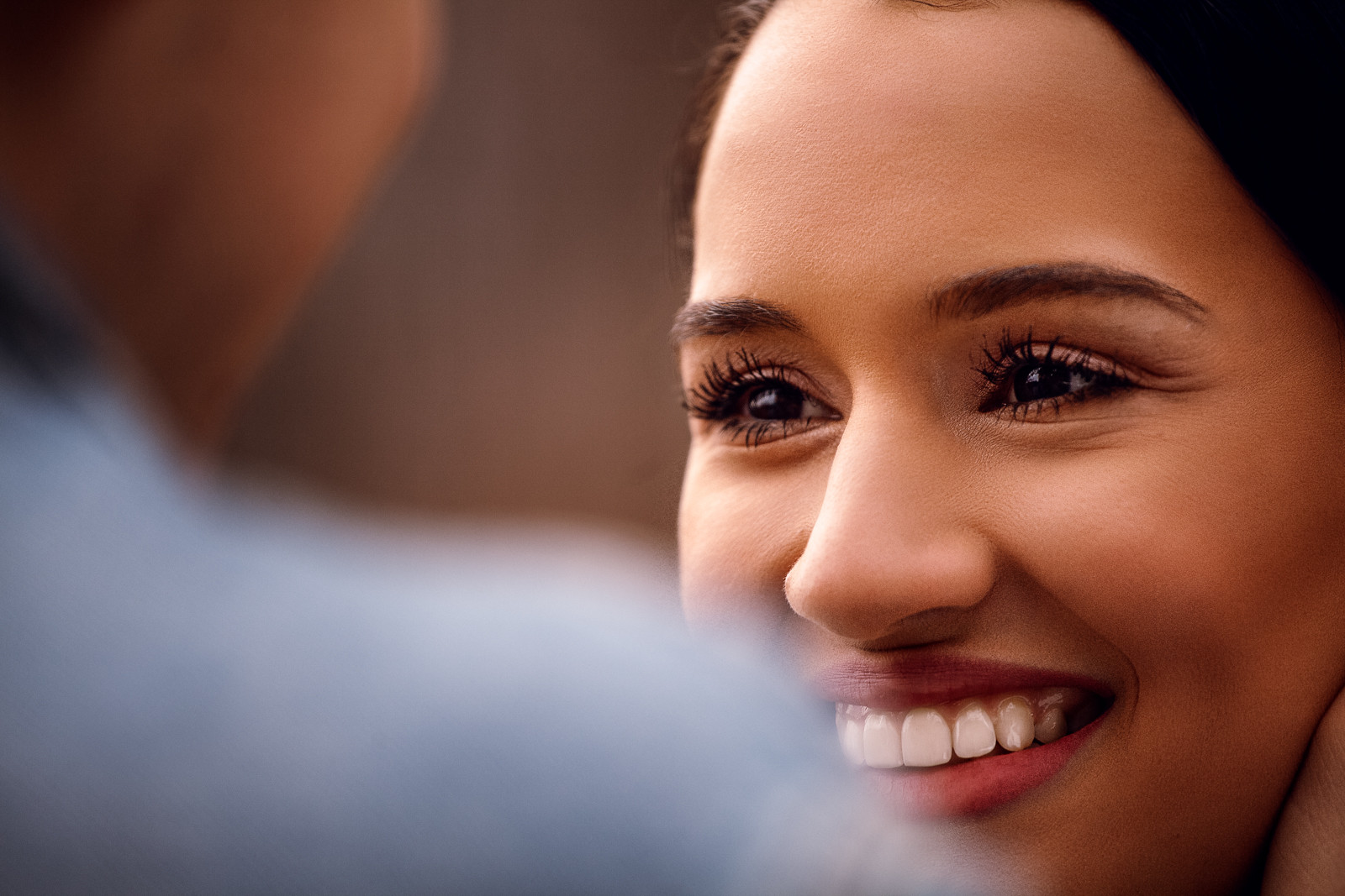close-up of the girls face as they're looking at each other's with the love in her eyes