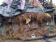 Cyclone damged hut.jpeg