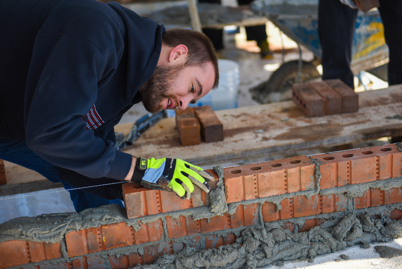 Jacob participates in a Bricklaying contest