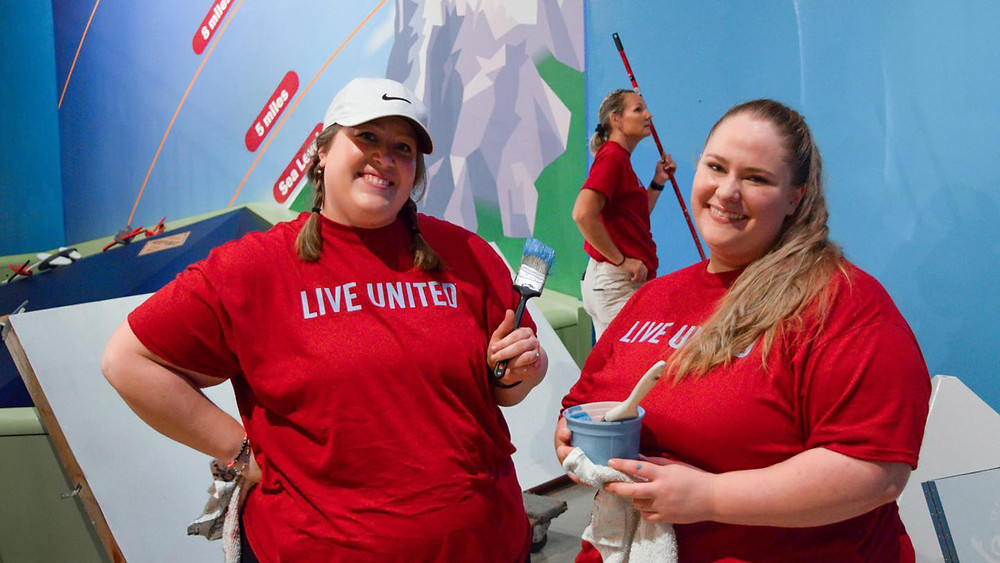 BRP Architects Nicole Shaul and Amber Summers help paint the Discovery Center of Springfield at United Ways Day of Caring