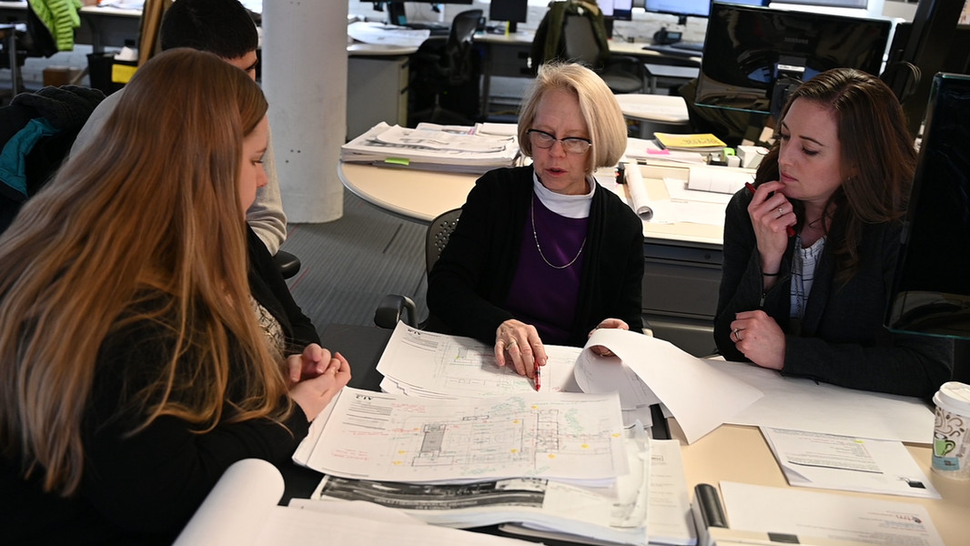 Project Manager Gerri discusses with the design team