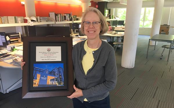 Gerri Kielhofner, BR&P Architect and Partner, with the Golden Trowel Award