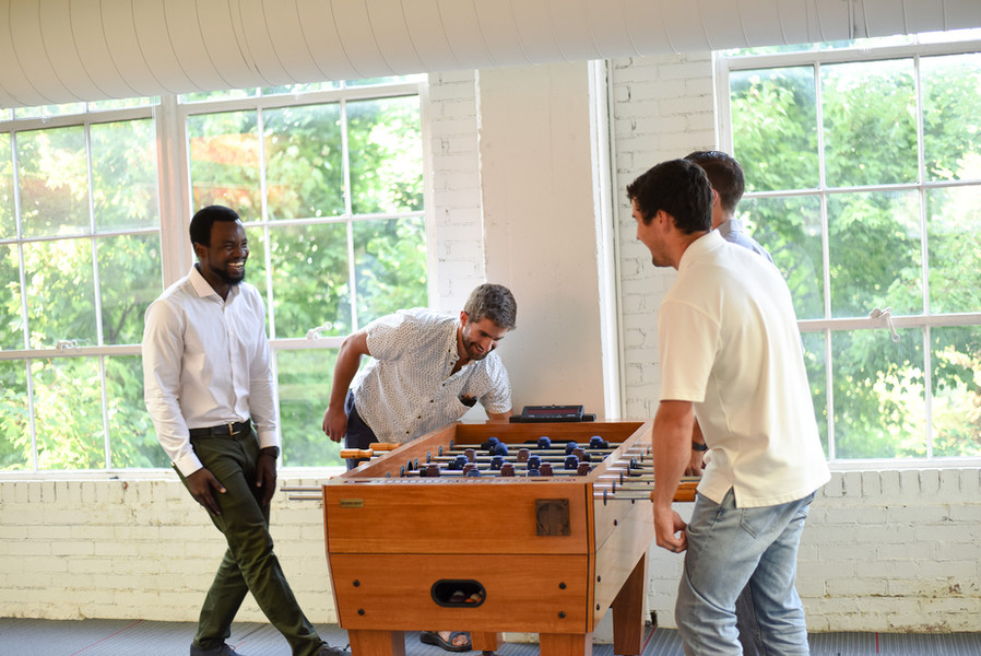 A competitve game of office foosball