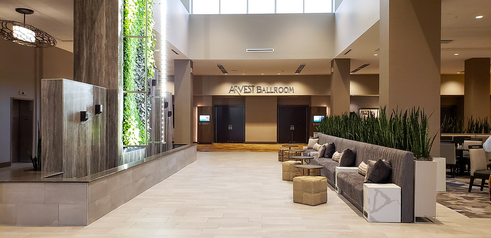 Embassy Suites Jonesboro- View of lobby couch and green wall