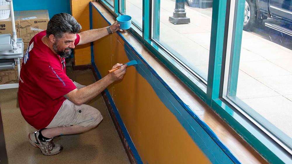 Managing Partner and Architect Chris Swan works on painting at the Discovery Center at United Way of the Ozarks Day of Caring event