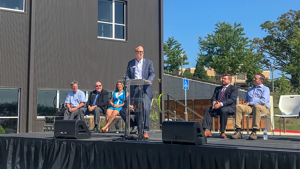 Tim Rosenbury at podium speaking at ceremony