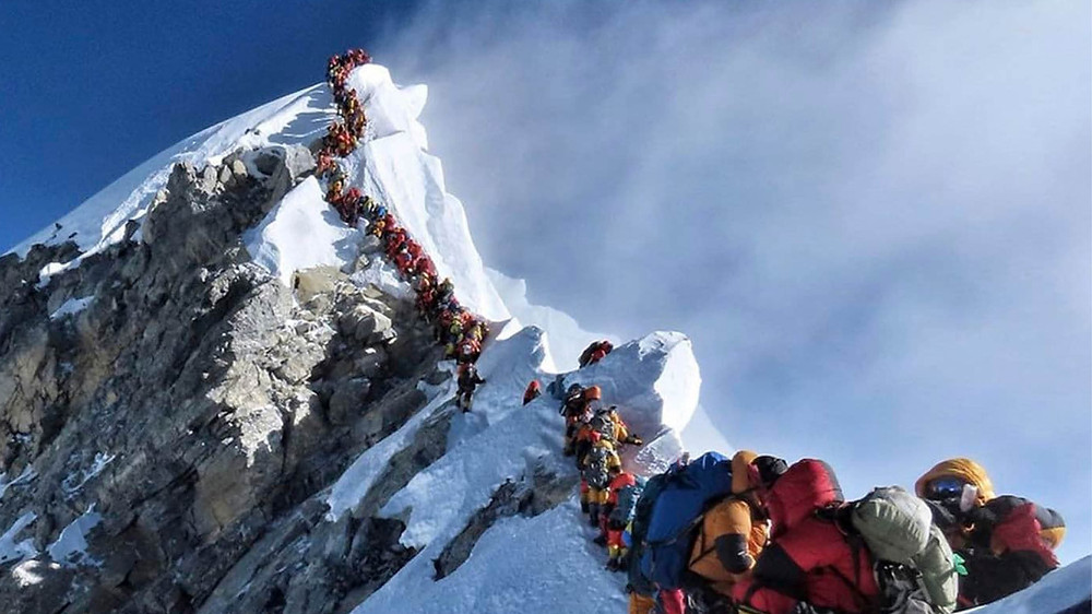 People climbing Mt. Everest