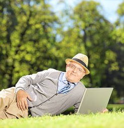 33244184-senior-man-with-hat-lying-in-pa